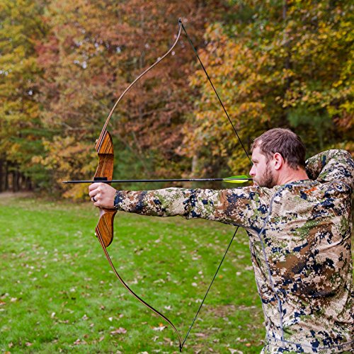 man aiming bow