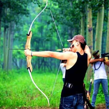 Man shooting and aiming