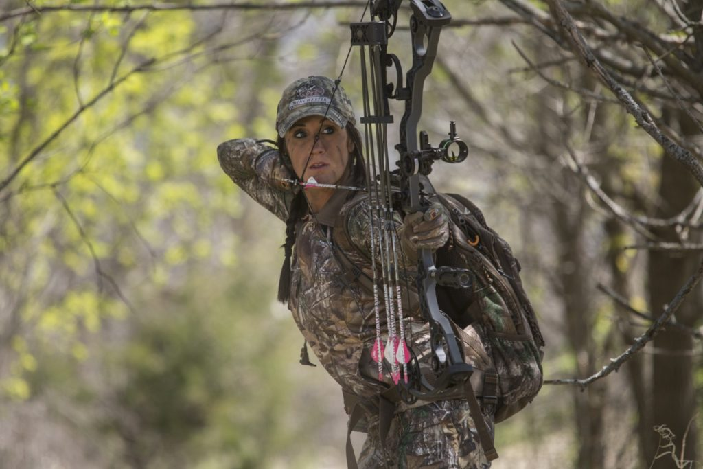 Woman bow hunting