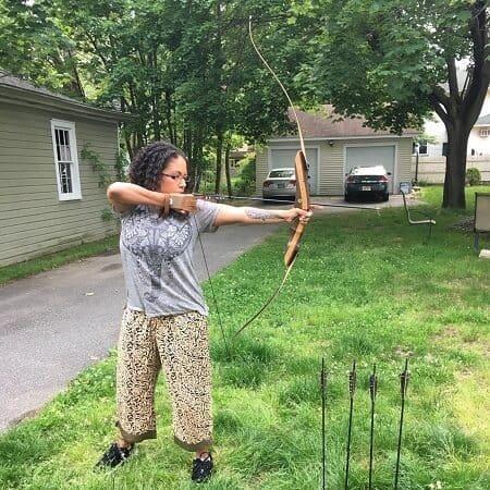 women shooting bow