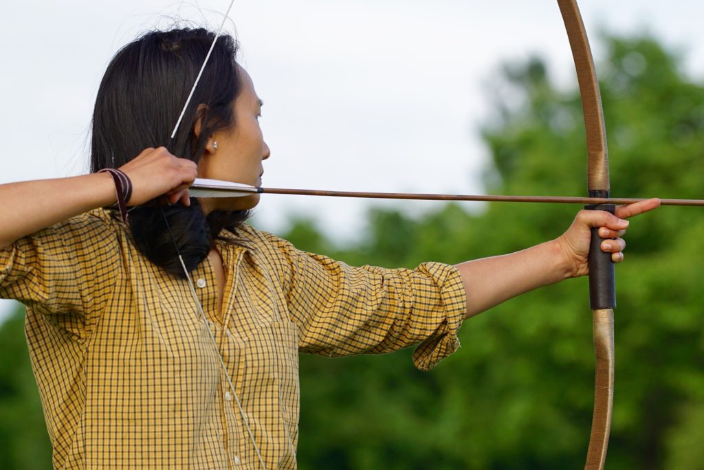 A wooden recurve bow can be used in many ways.