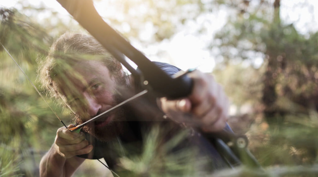 A guy shooting a Huntingdoor Traditional Longbow